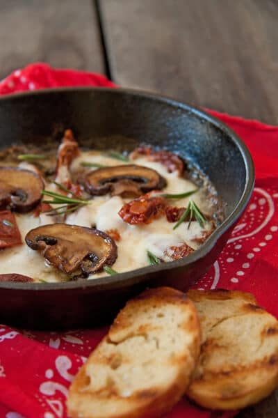 Mushrooms,-Sun-Dried-Tomatoes-and-Mozzarella dip in a skillet.