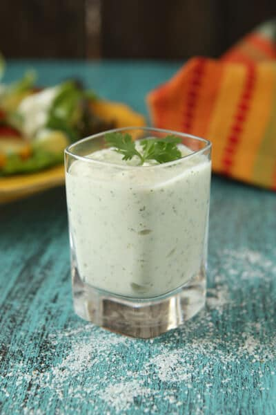 glass with green hatch chile dressing