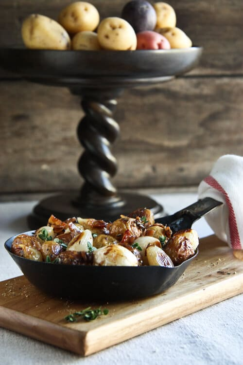 Cook these oven Roasted Potatoes with Bacon, Pearl Onions and Sherry Vinegar along with the main course for an easy, stress free side dish.