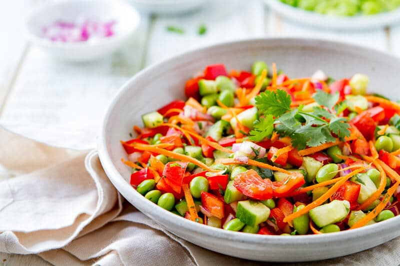 large bowl of my favorite asian salad recipe - edamame salad with ginger vinaigrette.