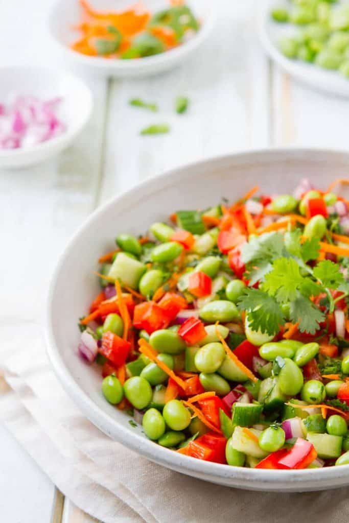 This easy Asian Edamame Salad with ginger vinaigrette makes a terrific main or side dish. Great for lunches, read on for how else to use this simple salad!
