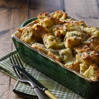 Easy cheese and herb bread pudding is just what it sounds like - easy and cheesy, it's a great side dish for the holidays!
