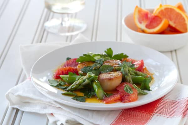 An elegant and easy make ahead appetizer or dinner recipe, these Scallops with Cara Cara Gastrique make the most of winter citrus.