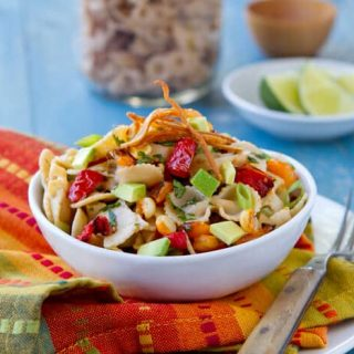 This Easy Mexican Style Pasta Salad with Chile Lime Dressing recipe is a summer potluck, party and backyard bbq star that can be made ahead.