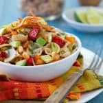 Bell peppers, avocado, whole wheat pasta and crispy tortilla strips all wrapped up in a zippy dressing make this Mexican Pasta Salad a salad you will crave again and again!
