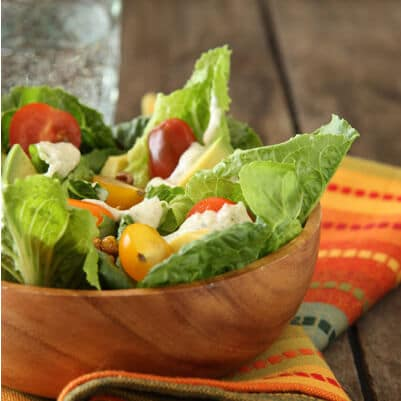 bowl of romaine salad with hatch green chile dressing