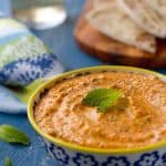 Kopanisti dip - a spicy and creamy dip from Greece, is flavored with red peppers, feta and mint. An Incredibly easy and delicious dip for any occasion.