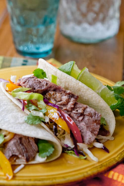 Michelada Marinated Steak Tacos - a great drink makes a great marinade for these easy, crowd pleasing steak tacos.