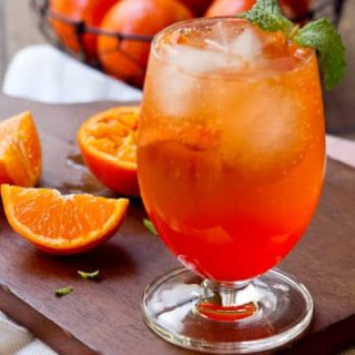 A twist on Italy's classic cocktail, this Aperol and Tangerine Spritz recipe combines Aperol with fresh tangerine juice for a refreshing summer sipper!