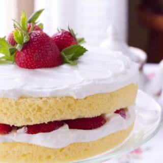 "This easy vanilla scented Sponge cake with Lemoncello Cream and Strawberries is the perfect make ahead recipe - the secret is in the ""cream""."
