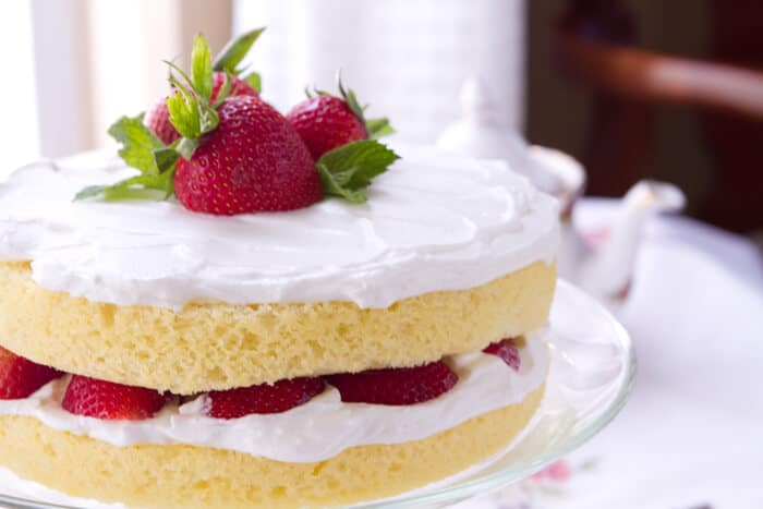 Sponge Cake with Lemoncello Cream and Strawberries on a platter