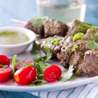 These grilled Mint, Coriander and Honey Kebabs are bathed in a sweet, tangy and herbaceous marinade that doubles as a dipping sauce.