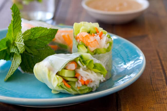 Gluten free Shrimp and Mint Summer Rolls with a zippy peanut sauce are the perfect party food! Set out the ingredients and let them roll!