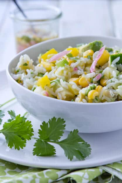 Sweet, sour, salty and crunchy this easy, make ahead roasted Hatch chile and lemon rice salad recipe goes great with anything off the grill!