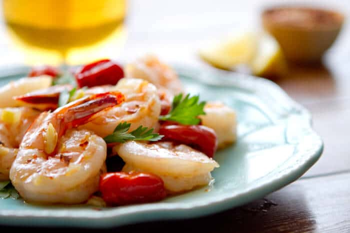 If you like shrimp scampi, you will love this easy, healthy one pan Oil Poached Spanish Sherried Shrimp recipe with lemon and tomatoes.