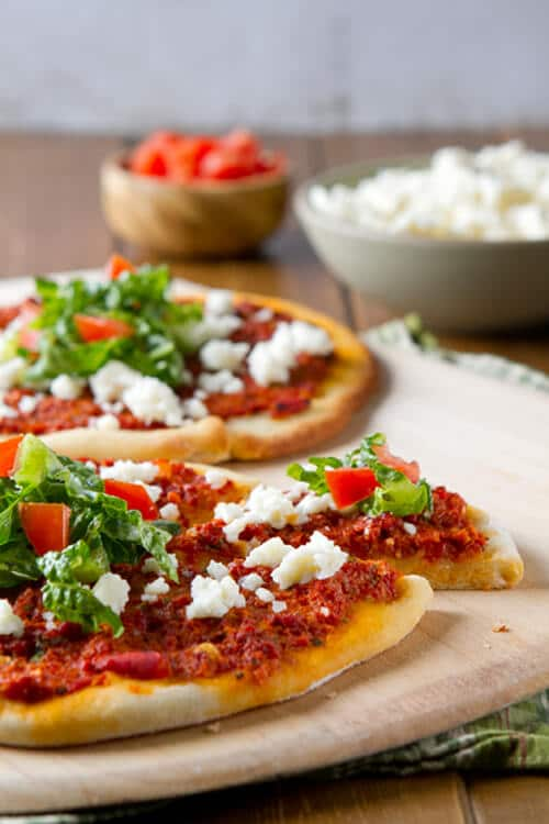 A latin take on a middle eastern flatbread,  Chorizo Flatbreads with Queso Fresco and Tomato Salad are an easy, nutritious weeknight dinner!