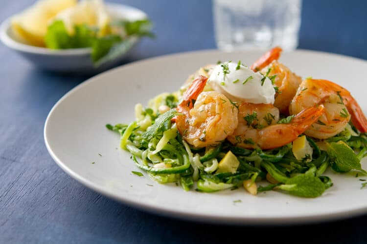 This healthy and gluten free Creamy Lemon Herb Shrimp bursts with fresh flavor! This easy, weeknight friendly one dish meal is pretty enough for company!