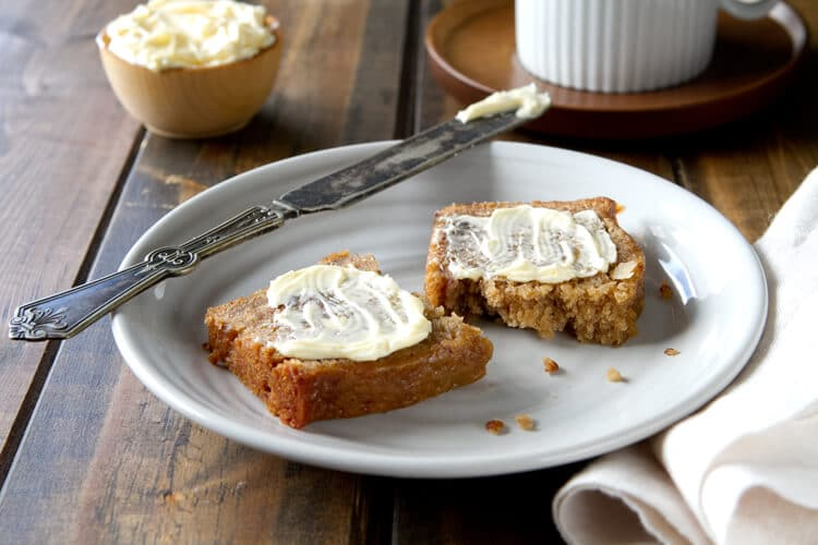 Slice of Van de Kamp's Date Nut Bread with butter on a plate.