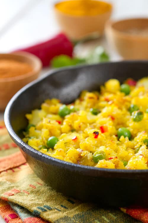 Fragrant with spices, this healthy, indian inspired Spiced Potato Hash recipe is a quick, colorful and nutritious vegetarian side dish.