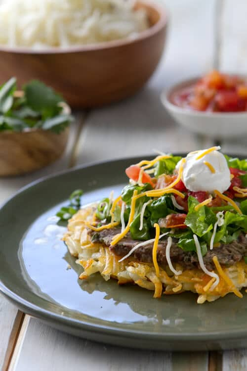 Frozen hash browns replace a tortilla in these Hash Brown Tostadas. Topped with lime and cilantro black beans it makes an easy 30 minute vegetarian dinner.