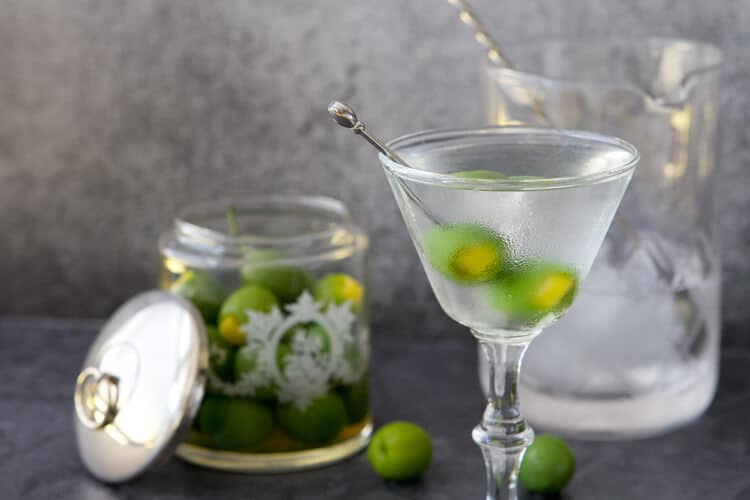 GIve the classic martini an update- this Mediterranean martini features a twist on the classic garnish with a burst of citrus flavor.