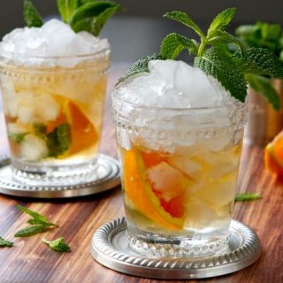 A riff on the Kentucky Derby classic Mint Julep, this Orange Mint Julep recipe is a great introduction to bourbon cocktails!