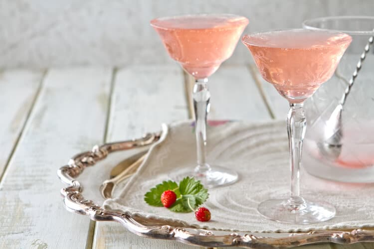 Two Rhubarb Fizz Cocktails on a tray.