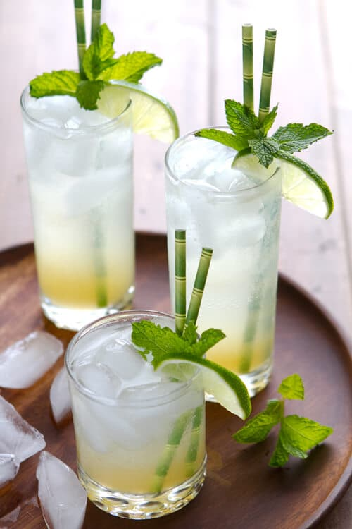 An infused simple syrup of with tropical flavors  is the secret to this refreshing Limeade Rum Fizz cocktail.