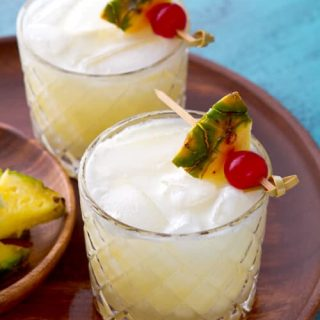 The traditional Pina Colada with a Twist. This recipe uses fresh lime juice to balance the sweetness of this classic cocktail - no blender required!