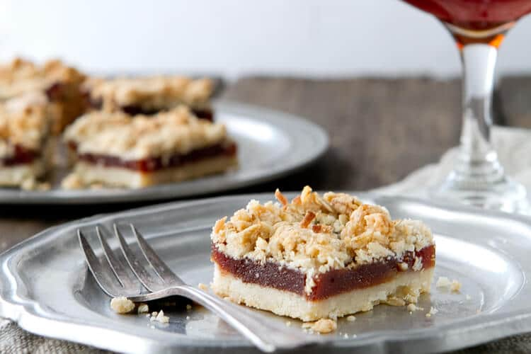 A buttery shortbread crust gets topped with guava paste and an oatmeal and coconut crumb topping.