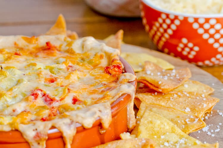 Hot, creamy and spicy Cacique Artichoke Dip - a great, make ahead dip for game day!