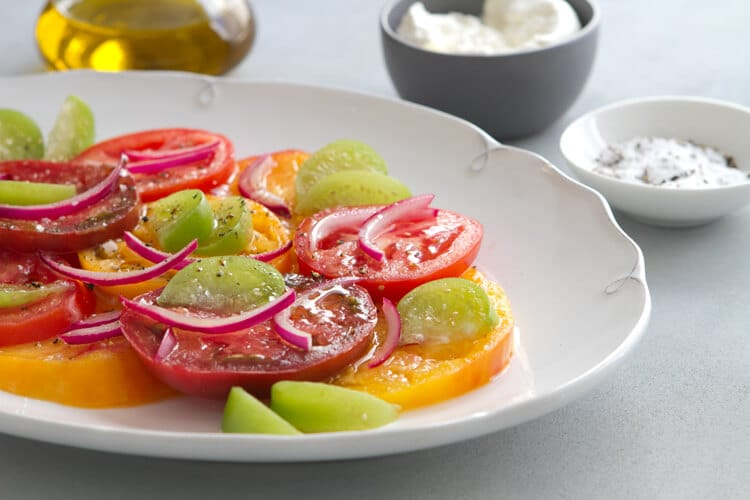 Tomatillos add a bright note to this healthy summer Tomatillo and Tomato salad recipe. Add burrata or avocado and dinner is served!