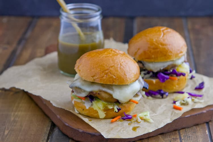 Easy grilled chicken slathered with tangy green chile sauce and gooey melted cheese makes these Chicken Green Chile Sliders irresistible!