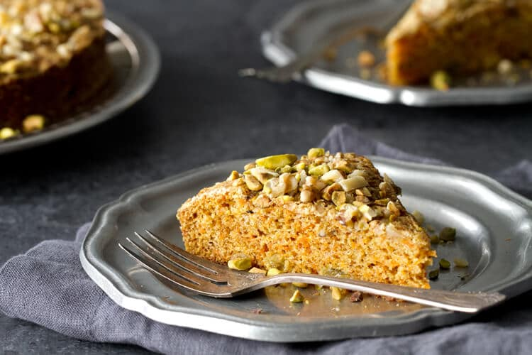 This Easy and Healthy Carrot Cake recipe is so moist, no frosting needed. Cardamon and pistachios give an Indian twist to this luscious cake.