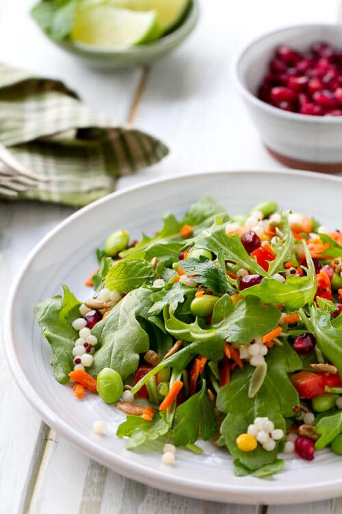 This vegetarian Vegetable Salad with Honey Lime Dressing recipe is sweet, sassy and full of legumes, greens, vegetables and grains.