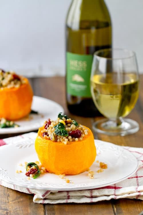 These middle eastern inspired Israeli Couscous Stuffed Butternut Squash Bowls are an easy, ideal holiday and fall make ahead vegetarian entree.