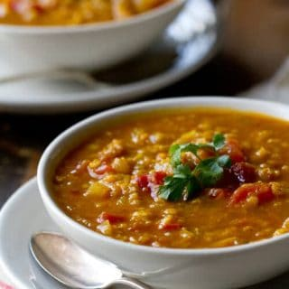 This vegan Indian Spiced Red Lentil Soup recipe uses an easy technique to create long simmered flavor in under 30 minutes.