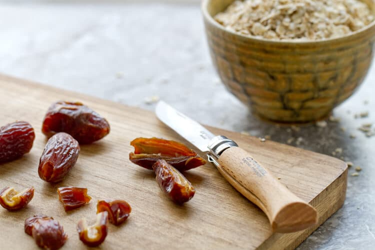 chopped up dates on a board for the Orange and Date Oatmeal