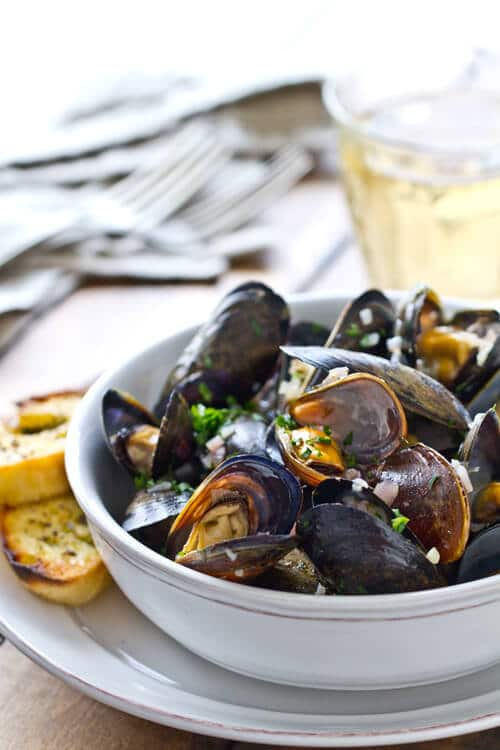 Quick mussels with garlic herb butter and white wine