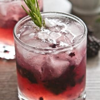 This Summer in Provence Cocktail is a smash! Crushed blackberries. gin, lemon juice and an infused rosemary thyme syrup make for easy summer sipping.