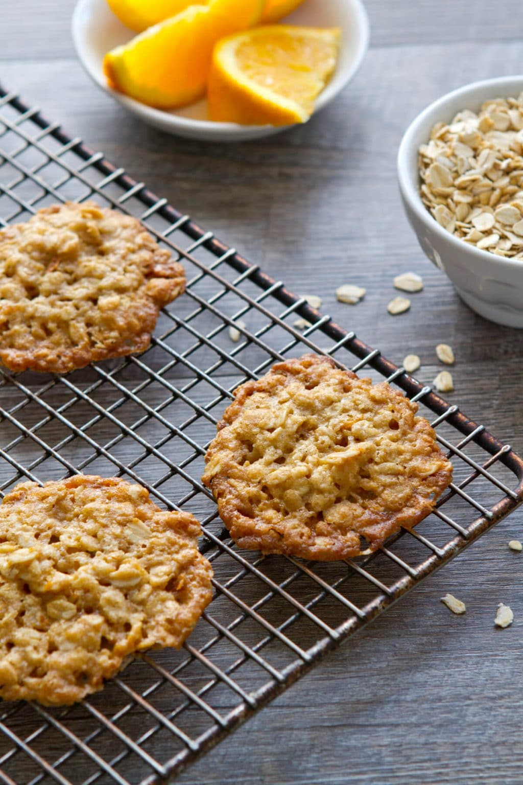 A little crispy, a little chewy, these one bowl Orange Ginger Oatmeal Crisps cookies are a healthy treat and are perfect with ice cream.