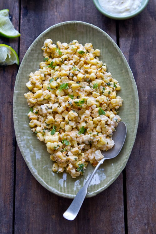 Lemon, lime, mayo and two cheeses flavor this Creamy Citrus Mexican Corn Salad that goes deliciously with anything from the grill!