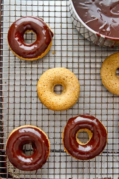Freshly milled whole wheat flour is the secret to these nutty, moist and delicious 1 hour Whole Wheat Chocolate Glazed Donuts.