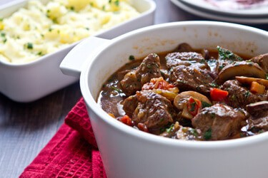 Chasseur Style Beef Stew is an easy and satisfying one pot french style beef stew with mushrooms, tomatoes, shallots and white wine that's ideal for winter.
