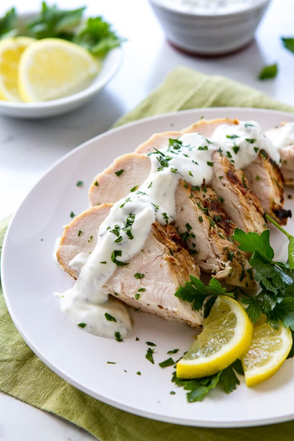 This Yogurt, Lemon and Mint Grilled Chicken recipe is incredibly moist, tender and juicy! So delicious and versatile you'll want leftovers!