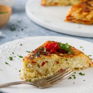 Eggs, cheese and red peppers come together in this easy Leftover Spaghetti Pasta Frittata. See my tips for this easy meal to have for dinner or brunch!