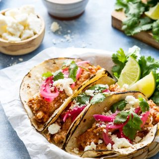 Juicy, tender and made in the slow cooker these mexican style pulled pork tacos have an earthy, citrusy flavor and are almost effortless!