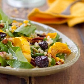 This Roasted Delicata Squash Salad with Apple Butter Vinaigrette recipe bursts with fall flavors! No peeling required and ready in under an hour!