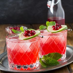 The holidays call for festive cocktails and what better way to welcome your guests then with this Pomegranate Lime Gin Fizz.