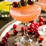 Sweet, tart and not too boozy, this easy vodka Ruby Red Cosmopolitan cocktail recipe is just right for a holiday or winter party.